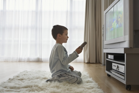 Boy Watching Television Stock Photo