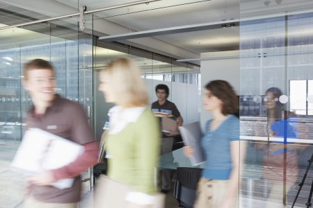 motion: Office workers leaving conference room long exposure