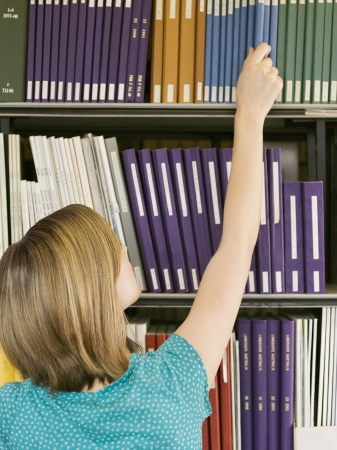 opting: Student Selecting Book in Library