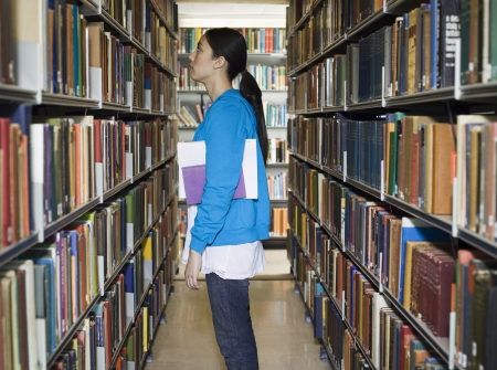 opting: Female Student Looking for Book in Library