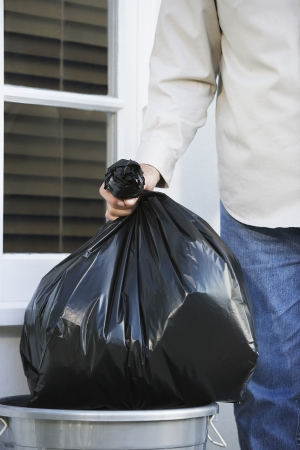 domestic task: Woman Putting Out Garbage Bag LANG_EVOIMAGES