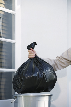 domesticity: Man Taking Garbage Out of Can
