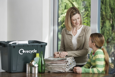 managing waste: Mother and Daughter Recycling Household Waste LANG_EVOIMAGES