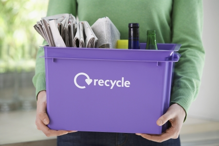 mundane: Woman Holding Recycling Container