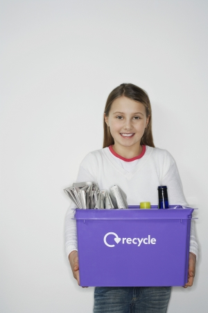 preadolescence: Pre-teen Girl Recycling Household Waste