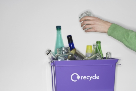 domestic task: Woman Placing Jar in Full Recycling Container