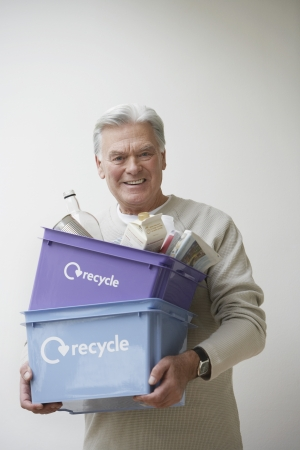 political and social issues: Senior Man Carrying Recycling Bin