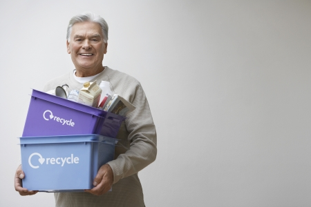 managing waste: Senior Man Carrying Recycling Containers LANG_EVOIMAGES