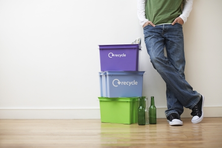 cropped off: Young Man Recycling Household Waste LANG_EVOIMAGES