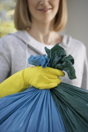 domestic task: Woman Carrying Garbage Bags