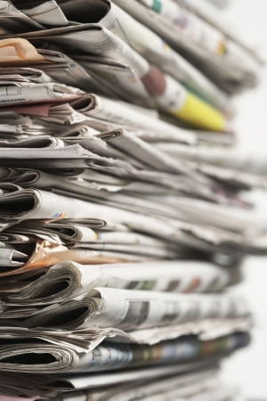 political and social issues: Stack of Newspapers