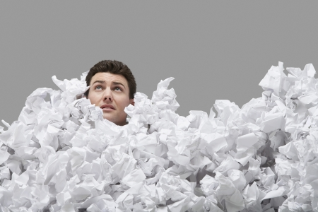 bussiness time: Man Buried in Crumpled Paper