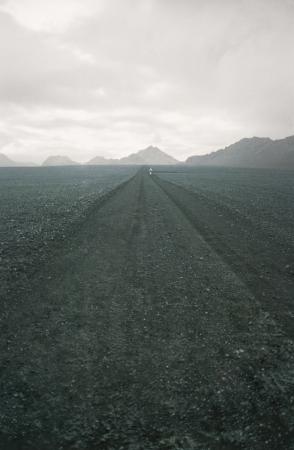 lonesomeness: Hiker in a Desolate Landscape LANG_EVOIMAGES