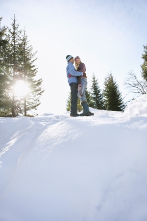 contented: Couple Hugging in Winter Landscape