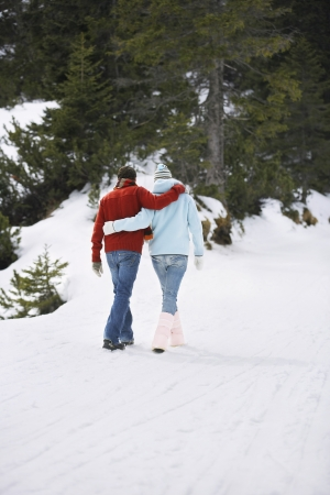 going nowhere: Couple Strolling in Winter Landscape