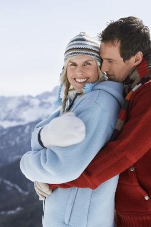 late thirties: Couple Hugging in Mountain Range LANG_EVOIMAGES