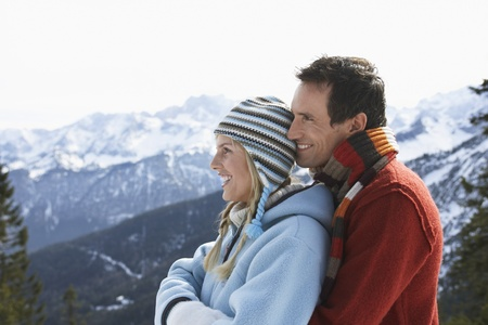 contented: Happy Couple in Mountain Range LANG_EVOIMAGES