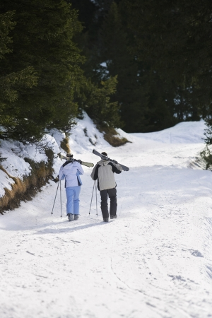 going nowhere: Two Skiers Walking in Winter Landscape