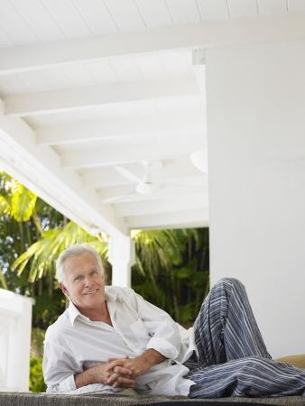 verandah: Man reclining on verandah portrait