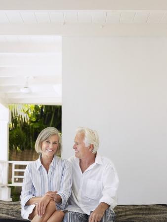 verandah: Senior couple sitting on verandah portrait
