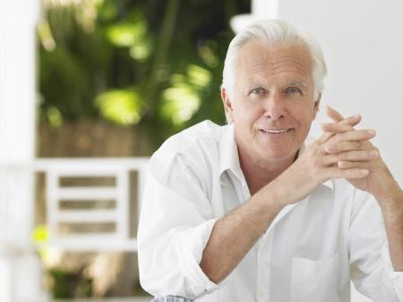 verandah: Man sitting on verandah portrait