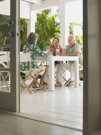 verandah: Three people sitting at verandah table