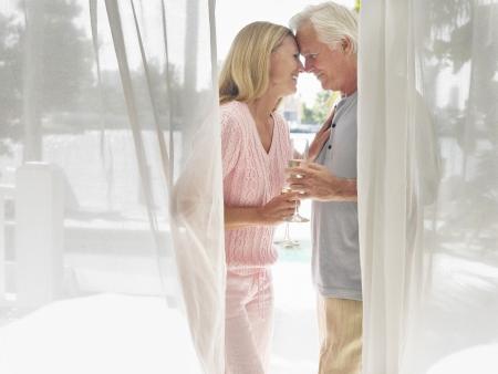 verandah: Couple standing on verandah face to face side view