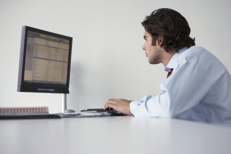 Business man using computer side view Stock Photo - 19465774