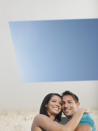 racially diverse: Affectionate Young Couple Under Skylight LANG_EVOIMAGES