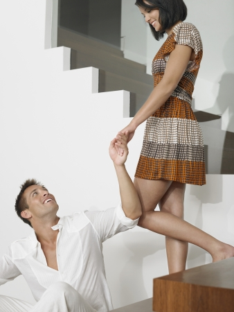 descending: Affectionate Young Couple on Stairs LANG_EVOIMAGES
