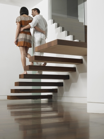 descending: Young Couple Descending Stairs