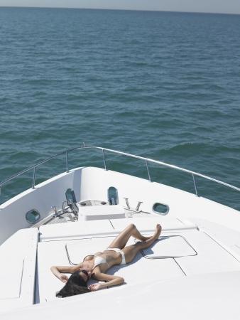 Young woman in bikini sunbathing on yacht elevated view Stock Photo - 19522587