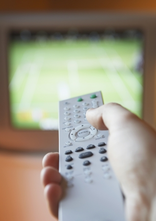 cropped off: Hand Holding Television Remote Control