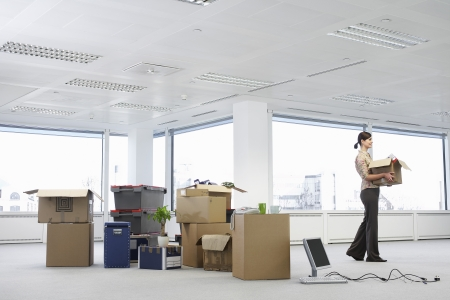 Businesswoman in Office with Moving Supplies