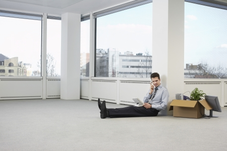 bussinessman: Businessman in Empty Office Using Phone