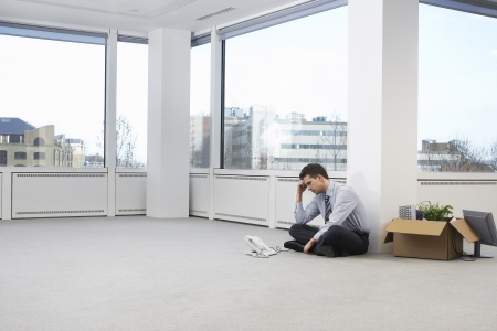 exasperation: Businessman in Empty Office Space