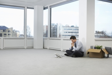bussinessman: Businessman in Empty Office Staring at Phone