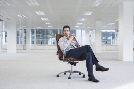business roles: Businessman in Empty Office