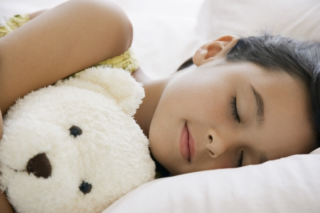 only 1 girl: Little Girl Sleeping with a Teddy Bear LANG_EVOIMAGES