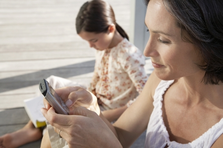 mobile phone adult: Mother Text Messaging