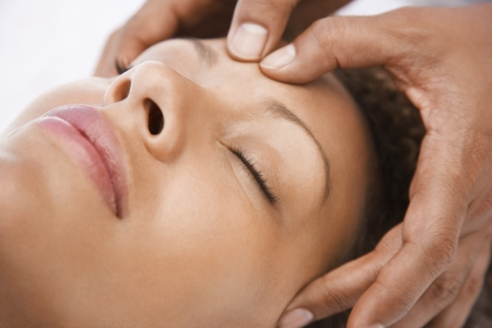 holistic therapy: Young Woman Getting Facial Massage