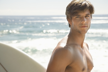 partially nude: Young Man Going Surfing Going Surfing