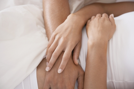 cropped out: Young Couple in Bed