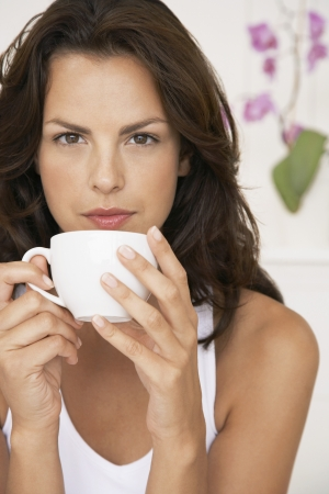 late thirties: Young Woman Drinking Coffee