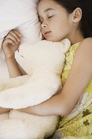 mundane: Little Girl Sleeping with a Teddy Bear LANG_EVOIMAGES