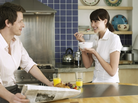 Young couple relaxing in kitchen Stock Photo - 19522885