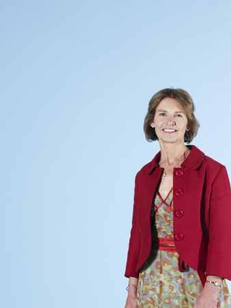 Middle-aged woman on blue background