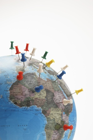 navigation aid: Push pins in various parts of globe studio shot LANG_EVOIMAGES