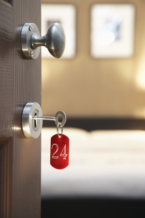 hospitality: Key in hotel rooms door LANG_EVOIMAGES