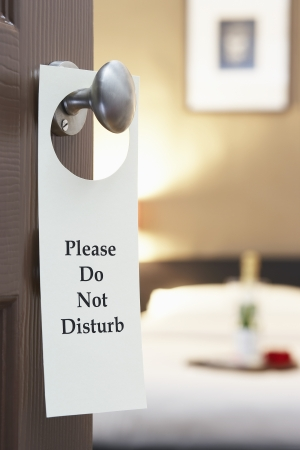 not open: Do Not Disturb sign on hotel rooms door